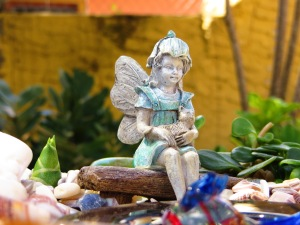 Fairy on bench and rooting plant